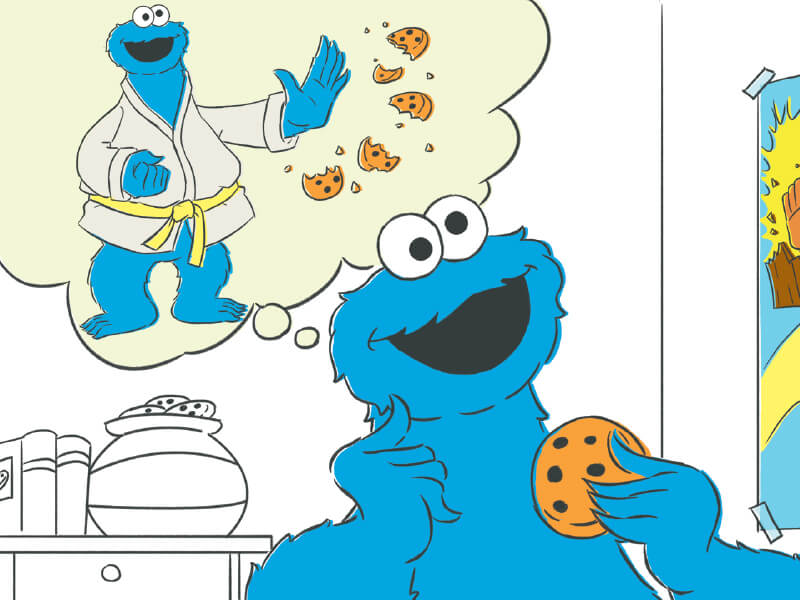 Cookie Monster thinking about karate chopping a cookie