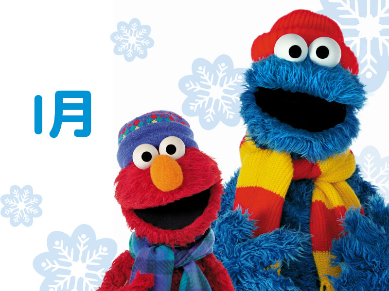Elmo and Cookie Monster in winter clothes